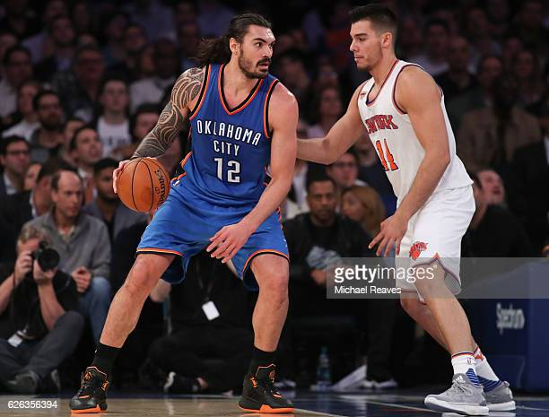 Steven Adams of the Oklahoma City Thunder drives to the basket defended by Willy Hernangomez of the New York Knicks during the second half at Madison...