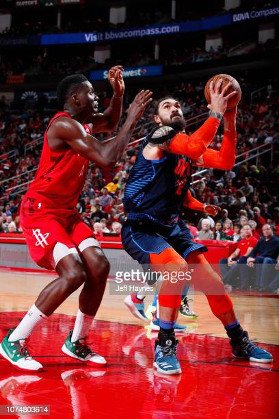 Steven Adams of the Oklahoma City Thunder drives to the basket during the game against Clint Capela of the Houston Rockets on December 25 2018 at the...