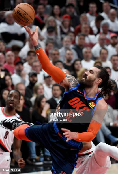 Steven Adams of the Oklahoma City Thunder drives to the basket past Al-Farouq Aminu of the Portland Trail Blazers during the first half of Game Five...