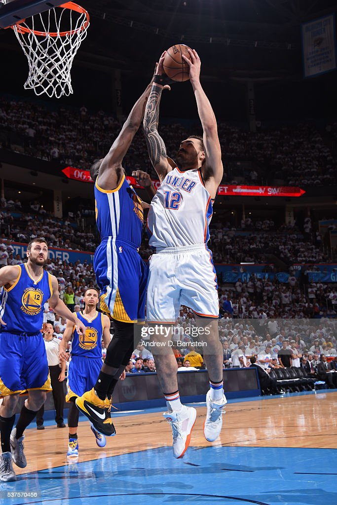 Steven Adams #12 of the Oklahoma City Thunder drives to the basket while guarded by Draymond Green #23 of the Golden State Warriors in Game Four of the Western Conference Finals during the 2016 NBA Playoffs on May 24, 2016 at Chesapeake Energy Arena in Oklahoma City, Oklahoma.