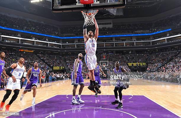 Steven Adams of the Oklahoma City Thunder dunks against the Sacramento Kings on November 23, 2016 at Golden 1 Center in Sacramento, California. NOTE...