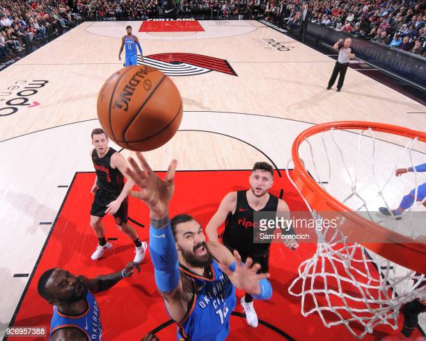 Steven Adams of the Oklahoma City Thunder dunks against the Portland Trail Blazers on March 3 2018 at the Moda Center in Portland Oregon NOTE TO USER...