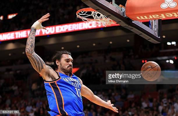 Steven Adams of the Oklahoma City Thunder dunks during a game against the Miami Heat at American Airlines Arena on December 27 2016 in Miami Florida...