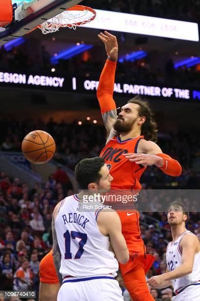 Steven Adams of the Oklahoma City Thunder dunks over JJ Redick the Philadelphia 76ers during a game at Wells Fargo Center on January 19 2019 in...