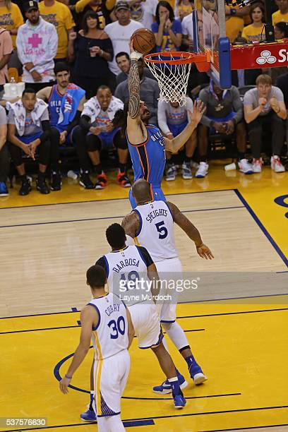 Steven Adams of the Oklahoma City Thunder dunks the ball against the Golden State Warriors in Game Five of the Western Conference Finals during the...