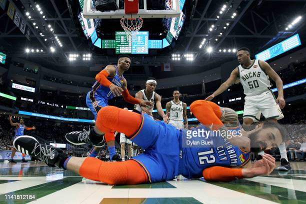 Steven Adams of the Oklahoma City Thunder falls to the court after being fouled in the second quarter against the Milwaukee Bucks at the Fiserv Forum...