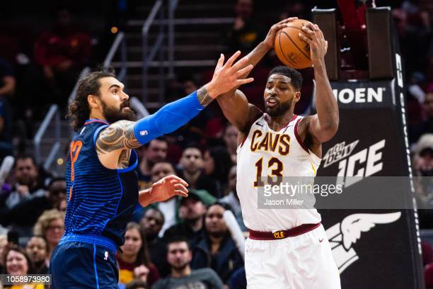 Steven Adams of the Oklahoma City Thunder fights Tristan Thompson of the Cleveland Cavaliers for a rebound during the second half at Quicken Loans...
