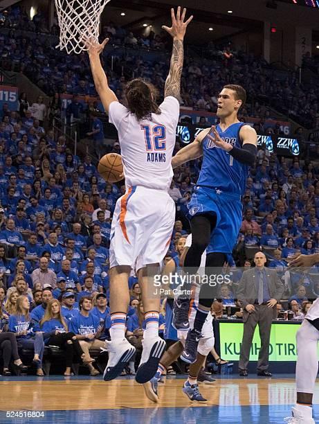 Steven Adams of the Oklahoma City Thunder forces Dwight Powell of the Dallas Mavericks to pass the ball off during Game Five of the Western...