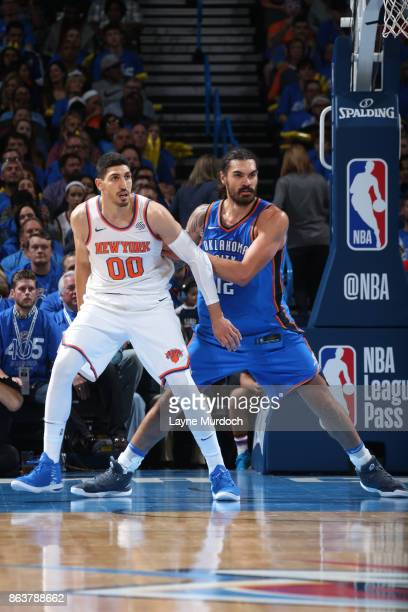 Steven Adams of the Oklahoma City Thunder guards Enes Kanter of the New York Knicks on October 19 2017 at Chesapeake Energy Arena in Oklahoma City...