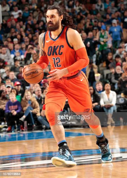 Steven Adams of the Oklahoma City Thunder handles the ball against the Dallas Mavericks on December 30, 2018 at the American Airlines Center in...