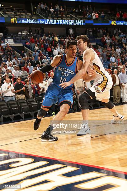 Steven Adams of the Oklahoma City Thunder handles the ball against the New Orleans Pelicans during the game on December 2 2014 at the Smoothie King...