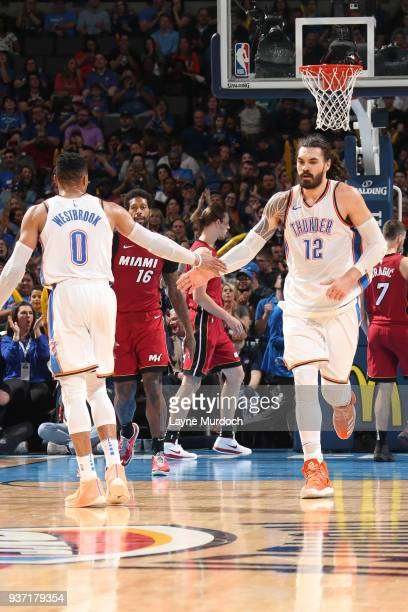 Steven Adams of the Oklahoma City Thunder high fives Russell Westbrook of the Oklahoma City Thunder during the game against the Miami Heat on March...