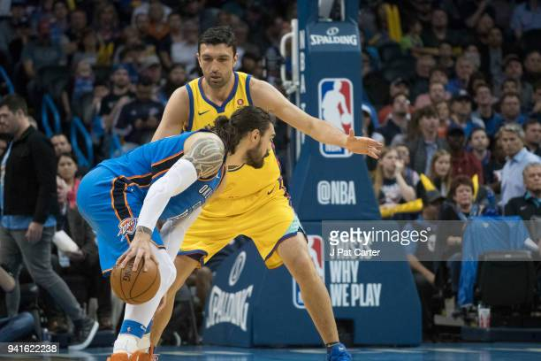 Steven Adams of the Oklahoma City Thunder looks for a shot as Zaza Pachulia of the Golden State Warriors applies pressure during the second half of a...