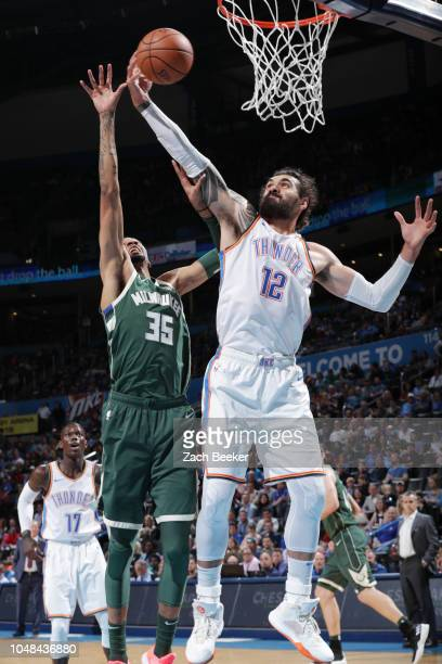 Steven Adams of the Oklahoma City Thunder rebounds the ball against the Milwaukee Bucks during a preseason game on October 9 2018 at Chesapeake...