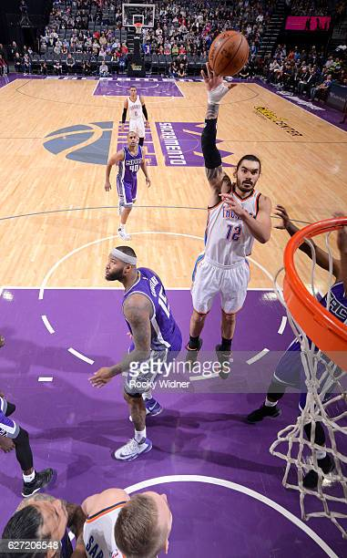 Steven Adams of the Oklahoma City Thunder shoots against DeMarcus Cousins of the Sacramento Kings on November 23 2016 at Golden 1 Center in...