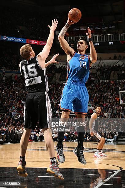 Steven Adams of the Oklahoma City Thunder shoots against Matt Bonner of the San Antonio Spurs at the ATT Center on December 25 2014 in San Antonio...