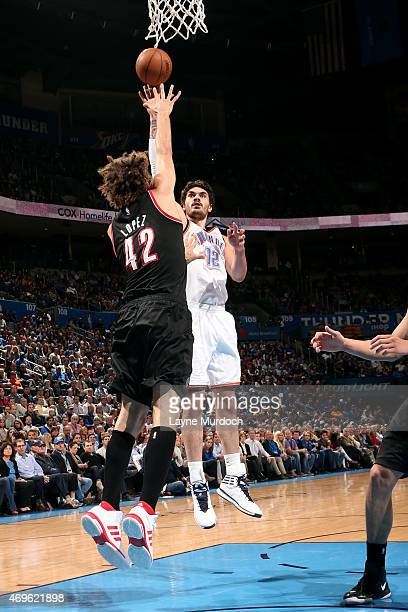 Steven Adams of the Oklahoma City Thunder shoots against the Portland Trail Blazers on April 13 2015 at Chesapeake Energy Arena in Oklahoma City...