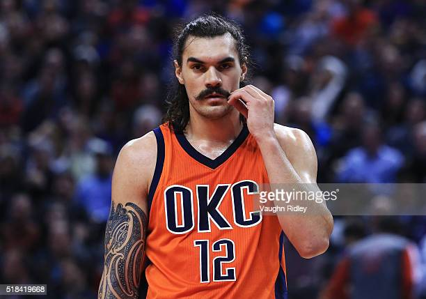 Steven Adams of the Oklahoma City Thunder twists his moustache during the first half of an NBA game against the Toronto Raptors at the Air Canada...