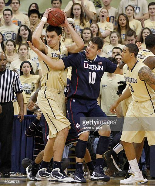 Steven Adams of the Pittsburgh Panthers defends against the Connecticut Huskies at Petersen Events Center on January 19, 2013 in Pittsburgh,...