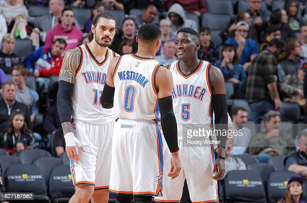 Steven Adams Russell Westbrook and Victor Oladipo of the Oklahoma City Thunder talk during the game against the Sacramento Kings on November 23 2016...