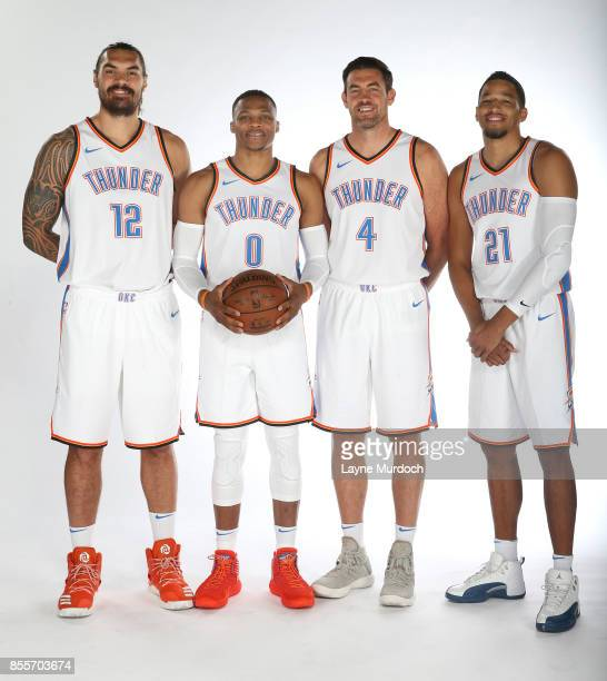 Steven Adams Russell Westbrook Nick Collison and Andre Roberson of the Oklahoma City Thunder pose for a portrait during the 2017 NBA Media Day on...