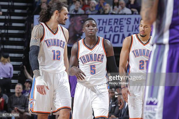 Steven Adams Victor Oladipo and Andre Roberson of the Oklahoma City Thunder look on during the game against the Sacramento Kings on November 23 2016...