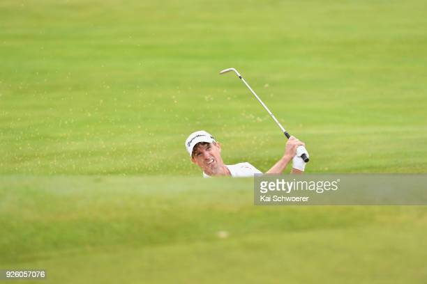 Steven Alker of New Zealand plays a bunker shot during day two of the ISPS Handa New Zealand Golf Open at The Hills Golf Club on March 2 2018 in...
