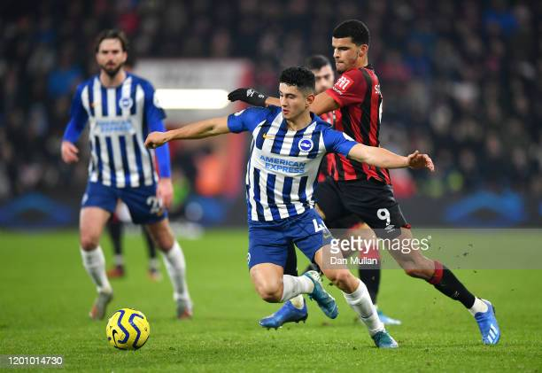 Steven Alzate of Brighton and Hove Albion battles for possession with Dominic Solanke of AFC Bournemouth during the Premier League match between AFC...