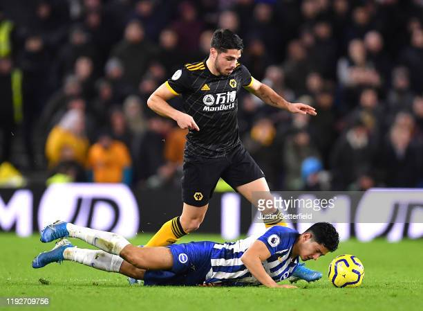 Steven Alzate of Brighton and Hove Albion is challenged by Pedro Neto of Wolverhampton Wanderers during the Premier League match between Brighton &...
