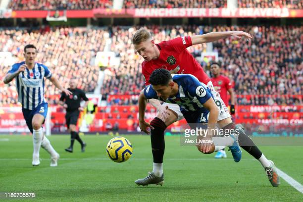 Steven Alzate of Brighton and Hove Albion is challenged by Scott McTominay of Manchester United during the Premier League match between Manchester...