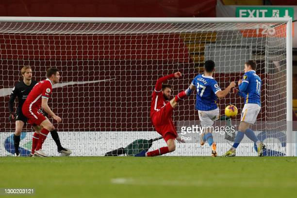 Steven Alzate of Brighton and Hove Albion scores their side's first goal during the Premier League match between Liverpool and Brighton & Hove Albion...