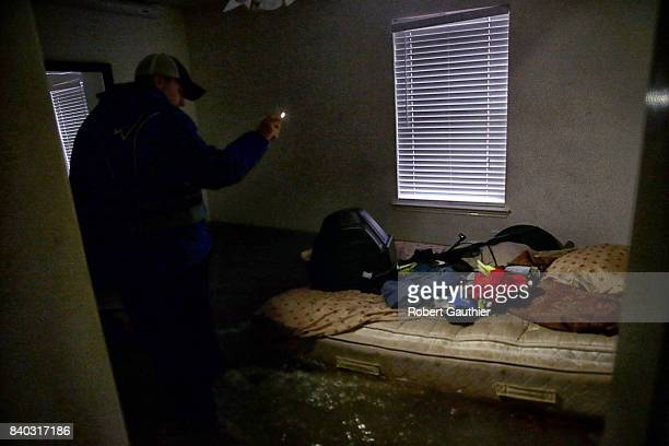 Steven Andersen searches an empty home for an injured woman that was reportedly stranded inside a Twin Oaks Village in Clodine