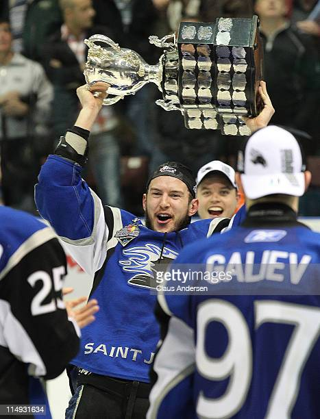 Steven Anthony of the Saint John Sea Dogs celebrates with the Memorial Cup after the win against the Mississauga St. Michael's Majors in the 2011 CHL...