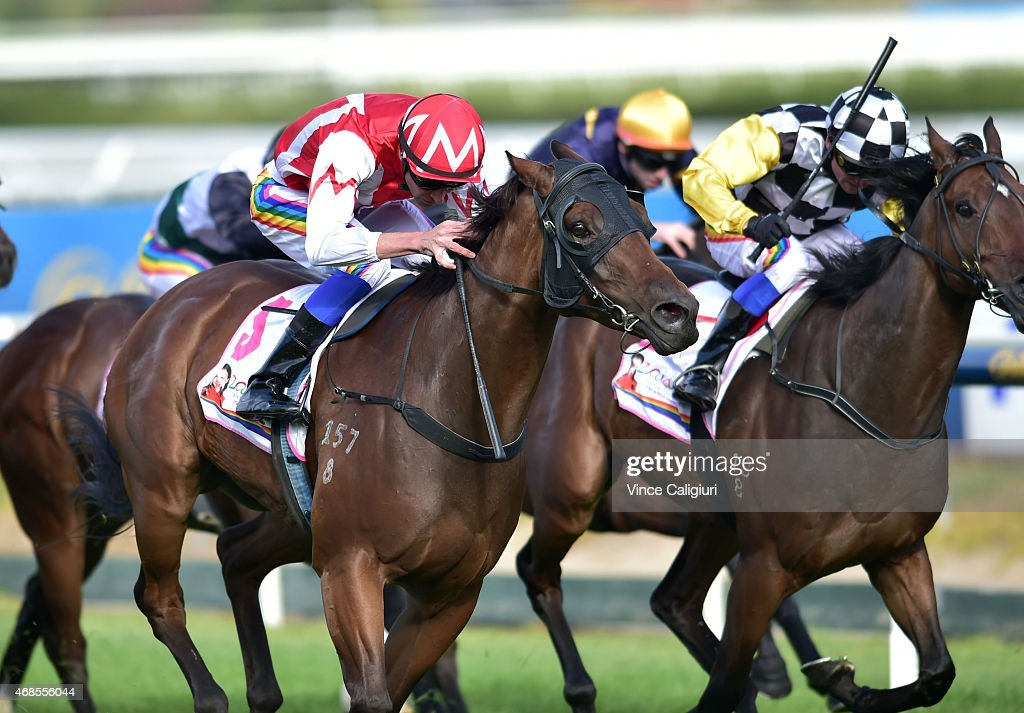 Steven Arnold riding Watermans Bay defeats Stephen Baster riding The Peak (r) in Race 8, the Victoria Handicap during Melbourne racing at Caulfield Racecourse on April 4, 2015 in Melbourne, Australia.