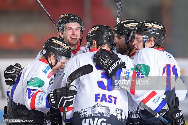Steven Baer, TJ Fast, Dustin Cameron and Marcel Kurth of the Heilbronner Falken celebrate after scoring the 0:1 during the game between ESV...