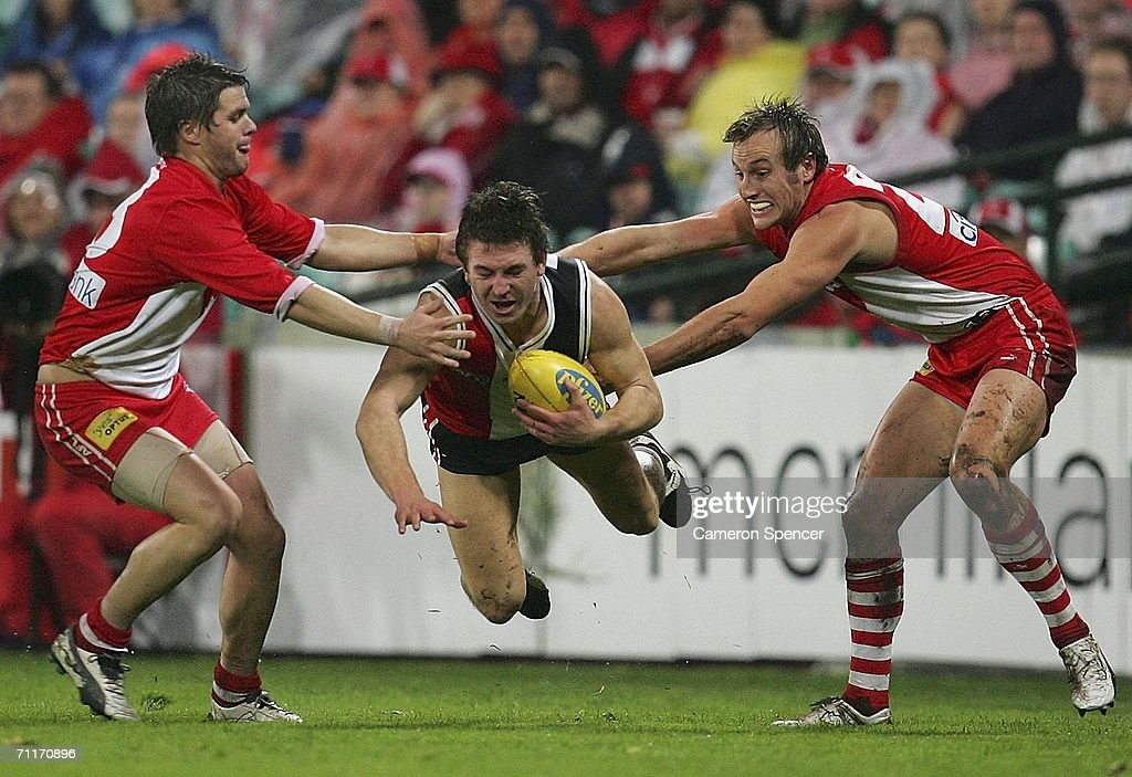 Steven Baker of the Saints is tackled during the round 11 AFL match between the Sydney Swans and the St Kilda Saints at the Sydney Cricket Ground June 10, 2006 in Sydney, Australia.