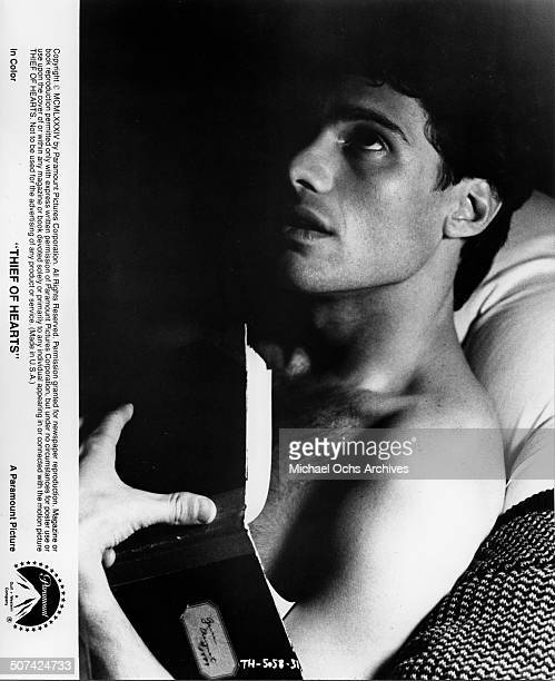 Steven Bauer thinks about the women whose diaries he has stolen in a scene from the Paramount Pictures movie Thief of Hearts circa 1984