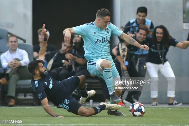 Steven Beitashour of Los Angeles FC and Jordan Morris of Seattle Sounders fight for control of the ball during the first half of a game at Banc of...