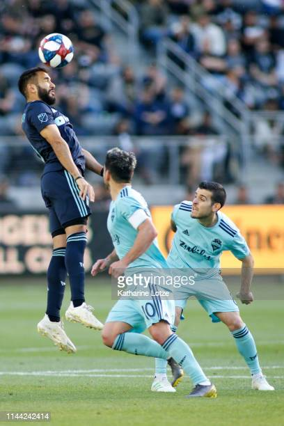 Steven Beitashour of Los Angeles FC heads the ball against the Seattle Sounders during the second half of a game at Banc of California Stadium on...