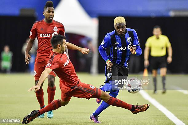 Steven Beitashour of the Toronto FC defends the ball against Ambroise Oyongo of the Montreal Impact during leg one of the MLS Eastern Conference...