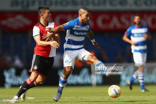 Steven Berghuis of Feyenoord battles for the ball with Jordy Tutuarima of De Graafschap during the Eredivisie match between De Graafschap and...