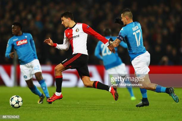 Steven Berghuis of Feyenoord battles for the ball with Marek Hamsik of Napoli during the UEFA Champions League group F match between Feyenoord and...