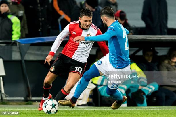 Steven Berghuis of Feyenoord Elseid Hysaj of SSC Napoli during the UEFA Champions League group F match between Feyenoord Rotterdam and SSC Napoli at...