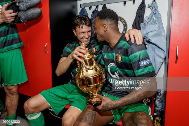 Steven Berghuis of Feyenoord Ridgecciano Haps of Feyenoord celebrate the championship with trophy in the dressing room during the Dutch KNVB Beker...