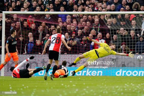 Steven Berghuis of Feyenoord scores his goal to make it 1-0, Olivier Boscagli of PSV, Lars Unnerstall of PSV during the Dutch Eredivisie match...