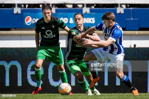 Steven Berghuis of Feyenoord Sofyan Amrabat of Feyenoord Arber Zeneli of sc Heerenveen during the Dutch Eredivisie match between sc Heerenveen and...