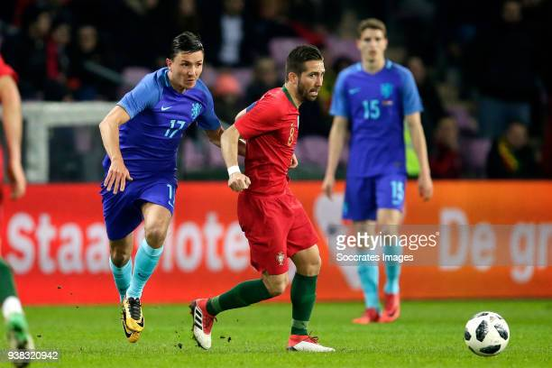 Steven Berghuis of Holland Joao Moutinho of Portugal during the International Friendly match between Portugal v Holland at the Stade de Geneve on...