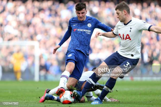 Steven Bergwijn and Ben Davies of Tottenham tackle Mason Mount of Chelsea during the Premier League match between Chelsea FC and Tottenham Hotspur at...