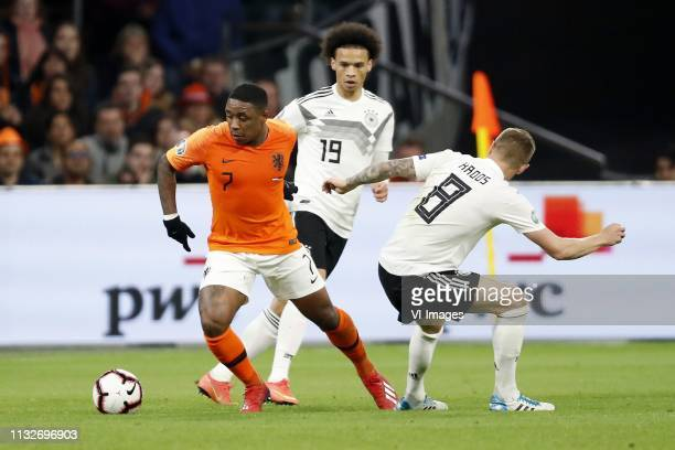 Steven Bergwijn of Holland Leroy Sane of Germany Toni Kroos of Germany during the UEFA EURO 2020 qualifier group C qualifying match between The...