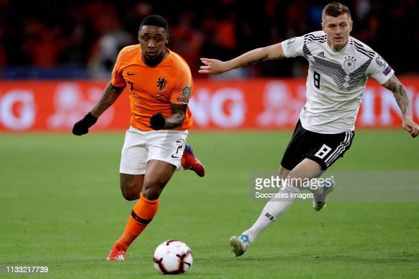 Steven Bergwijn of Holland Toni Kroos of Germany during the EURO Qualifier match between Holland v Germany at the Johan Cruijff Arena on March 24...